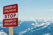 stock photo of avalanche  - Avalanche sign and mountains at the background - JPG