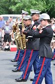 The Usmc Marine Forces Reserve Band Performers Playing Saxophones In A Parade