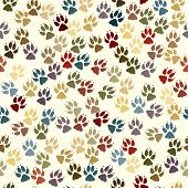 Editable vector seamless tile of dog paw prints