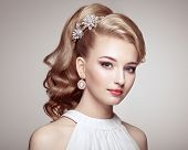 Fashion Portrait Of Young Beautiful Woman With Jewelry And Elegant Hairstyle poster