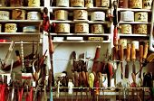 Classic handyman's workshop, with vintage hand tools and well-organized tins of nails, screws, etc.