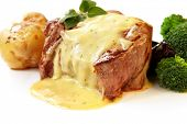 Filet Mignon ~ perfectly grilled thick-cut beef steak, with bearnaise sauce, baby roast potatoes, an