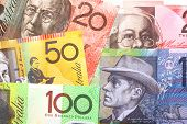 Background of Australian notes ~ one hundred, fifty, twenty and ten dollar notes.  Full-frame.