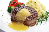 Thick-cut beef filet steak with Bearnaise sauce, served with mashed potatoes, broccoli and red bell