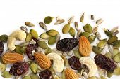 Trail mix of dried fruit and nuts, isolated on white.