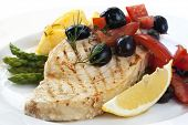 stock photo of swordfish  - Swordfish with an olive and tomato salsa - JPG