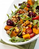 Salad with chickpeas, roasted vegetables, baby beets, cherry tomatoes, and arugula.  Delicious veget