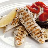 Grilled chicken tenderloin breast strips, with a salad of red capsicum and eggplant.