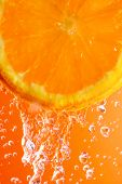 Orange Slice And Water Droplets