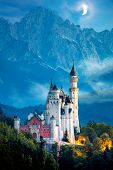 Original view of world-famous Neuschwanstein Castle at night with moon and fog, Germany, European la poster