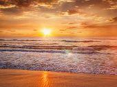 Beach holidays vacation background - peaceful serene morning sunrise on beach poster