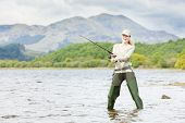 picture of fisherwomen  - fishing woman Loch Venachar Trossachs in Scotland - JPG