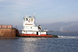 picture of coal barge  - tugboat transporting coal barges to be refilled and used for electrical production - JPG