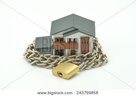 poster of Model House Wrapped With Steel Chain And Padlock. Ideas Security. Using As Background Business Conce
