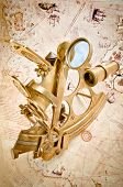 Antique Polished Brass Sextant Over Old Navigation Chart (Public Domain - Copyright Expired)