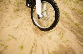 Detail View At Dirtbike Front Wheel On Muddy Rural Road In Countryside. Part Of Otocross Bike, Begin poster