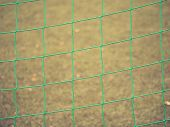 Detail Of A Soccer Net Against Green Grass On Stadium. Selective Focus With Detailed Knots poster