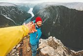 Couple Adventurers In Mountains Follow Helping Hand Traveling Together Lifestyle Concept Extreme Vac poster