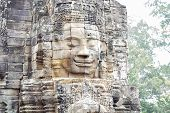 Stone Face Ruin Of Ancient Buddhist Temple Bayon In Angkor Wat Complex, Cambodia. Ancient Architectu poster