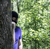 Maniac, The Killer In A Black Mask Is Behind A Tree With A Knife, Close-up, Killer With A Knife In T poster