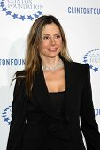 .LOS ANGELES - OCT 14:  Mira Sorvino arriving at the Clinton Foundation