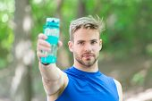 Man With Athletic Appearance Holds Bottle With Water. Man Athlete In Sport Clothes Training Outdoor. poster