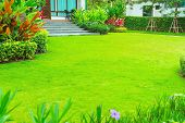 Modern House With Beautiful Landscaped Front Yard, Lawn And Garden Blur Background., The Design Conc poster