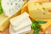 Pile Of Pieces Of Different Soft And Semi-soft Cheese With Mold, Medium-hard And Hard Cheese Closeup poster