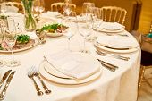 Table Setting With Blank Guest Card On Empty White Plate And Cutlery On Table, Copy Space. Menu Mock poster