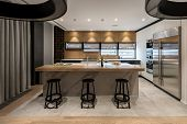 Kitchen In A Modern Style With Light Walls And A Parquet And Tiles On A Floor. There Are Lockers, Sh poster