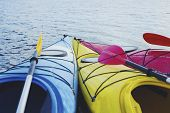 Kayaking On The Lake Concept Photo. Sport Kayak On The Rocky Lake Shore. Close Up Photo. poster
