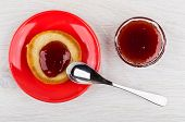 Pancake With Jam In Saucer, Bowl With Strawberry Jam, Spoon On Wooden Table. Top View poster