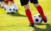 Kids Junior Football Training Session. Soccer Training For Children. Close Up Of Child Soccer Player poster