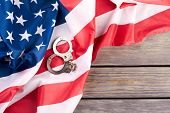 Usa Flag And Handcuffs, Top View. Usa Flag With Steel Handcuffs And Copy Space. Usa Legal System Con poster