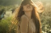 Sensual Girl With Full Lips And Fluttering Shinning Hair At Sunset On Green Meadow. Sensual Girl In  poster