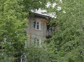 Soviet Apartment Building. Apartment Block. Soviet Architecture. Green Trees. Thickets. Concrete Apa poster