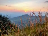 Sunset In Mountain Landscape. Mountain Layers In Sunset. Blue Mountains And Last Sun Lights Landscap poster
