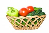 Basket With Some Cucumbers, Tomatoes And Sweet Peppers