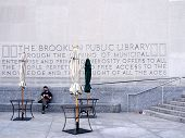 Man reading outside Brooklyn Public Library
