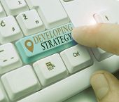 Text Sign Showing Developing Strategy. Conceptual Photo Game Plan That Sets Specific Goals And Objec poster