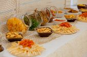 A Lots Of Salty Snacks On A Table, Many Cheese And Crackers On The Table With Snacks poster