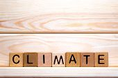 Word Climate Written With Wooden Cubes. Climate Emergency Concept. Climate Change. Ecological Situat poster