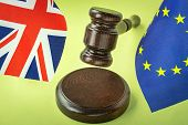 Eu And Uk Flags With Gavel. Crime, Justice And The Law Implications Of Brexit Concept poster