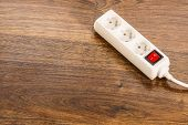 Electricity At Home. White Electric Power Strip Or Extension Cord Block For Extending Plug With Red  poster
