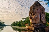 Details Of Stone Faces Sculpture And Rock Carvings At Gate Of Bayon Wat In Angkor Thom Temple, World poster