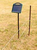Solar electric livestock fence charger and fencing