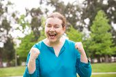 Joyful Excited Woman Shouting For Joy, Laughing, Celebrating Good News. Middle Aged Woman In Casual  poster