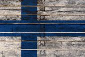 National Flag  Of Finland On A Wooden Wall Background. The Concept Of National Pride And A Symbol Of poster