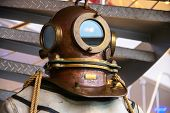 Close-up Helmet Old Vintage Three-bolt Deep-sea Diving Suit. Suit For Deep Sea Diving Of The Last Ce poster