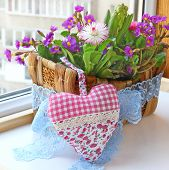 Floral Composition In A Small Basket And Sewn Together Heart As A Romantic Gift
